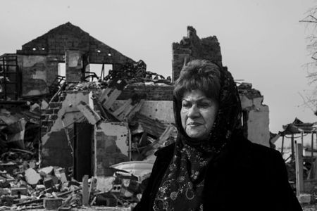 During the war Anna's house in Semenovka was destroyed by shells. Her husband has died of heart attack being unable to overcome the stress