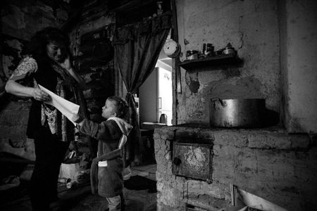Little Polina resides with her parents in a falling apart house. Local authorities planned to demolish it back in 1980s but it never happened