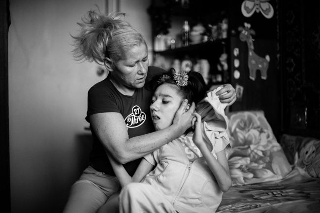 "Arik Shraga. ""Joint"" Families: The Stories of Love. Masha and her mother"