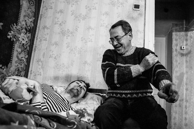 "Arik Shraga. ""Joint"" Families: The Stories of Love. Kherson. Dima with his father"