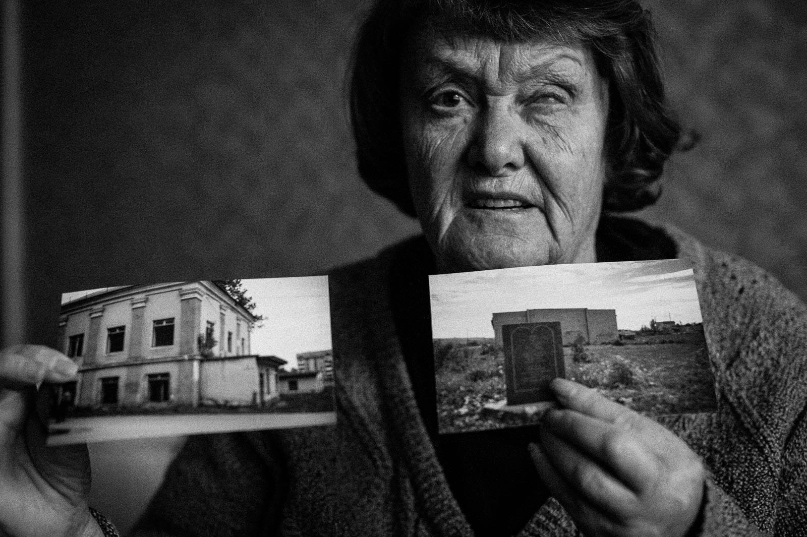 Arik Shraga. Central Ukraine. Alexandra shows the pictures of a ghetto where her family was murdered